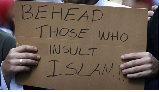A protester holds a homemade sign during a rally in Sydney's central business district, Sept. 2012.