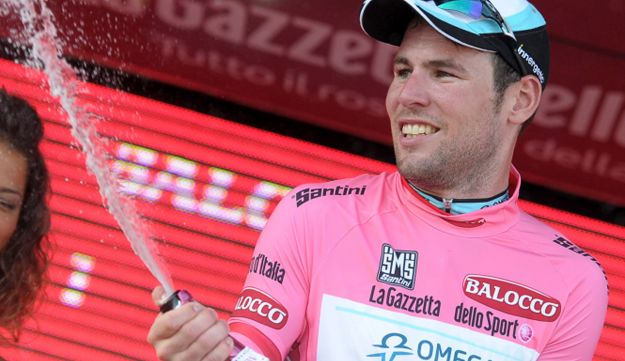 Mark Cavendish popping the bubbly after race