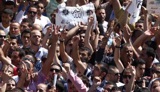 Palestinians chant slogans during a protest against a film mocking Islam in Jerusalem's Old City