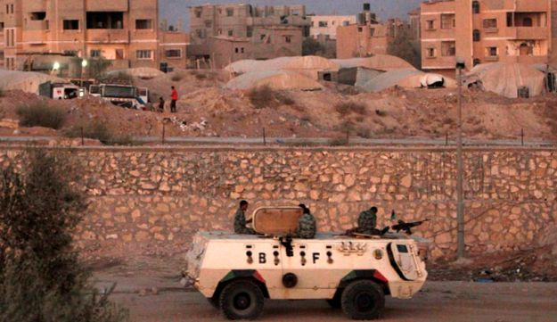 An armored vehicle patrols the border with Gaza Strip.