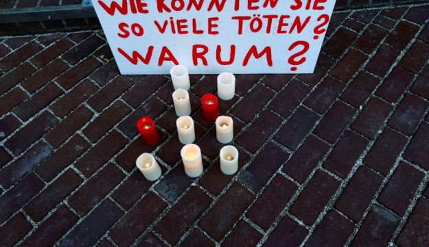 Candles placed in front of Munich courthouse.