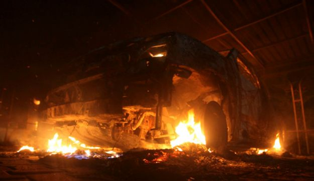 A burning car at the U.S. Consulate in Benghazi - Reuters - September 11, 2012.