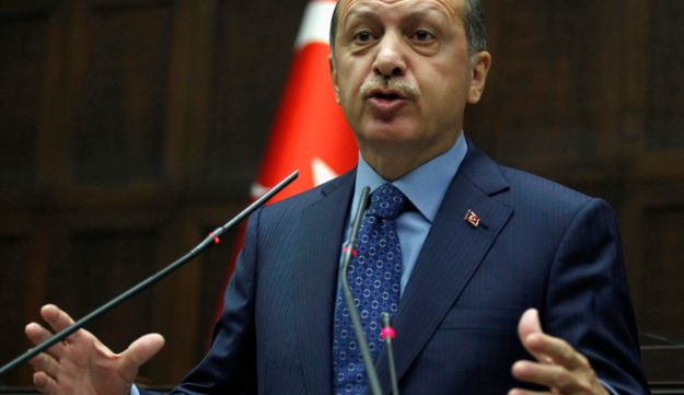 Turkish Prime Minister Recep Tayyip Erdogan addresses members of parliament