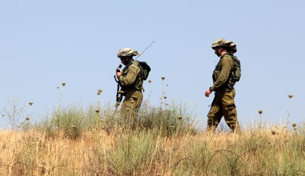 Israeli soldiers patrol the border with Syria.
