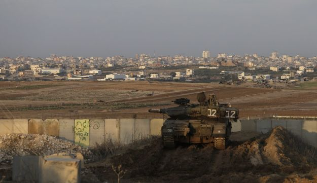 An Israeli tank is parked in a position overlooking the Gaza Strip