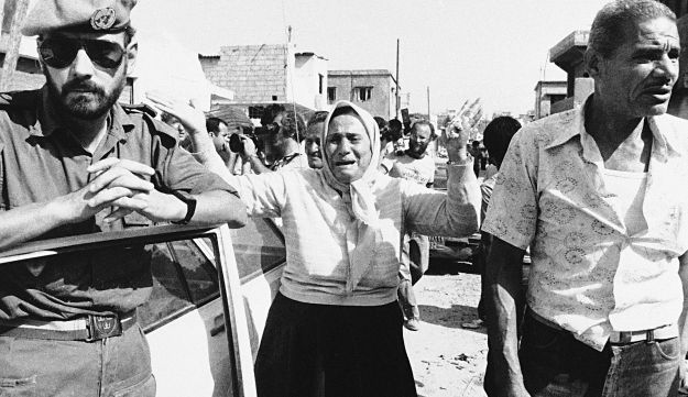 A Palestinian woman screams at a Swedish United Nations officer  in the Sabra PLO Camp in Beirut.