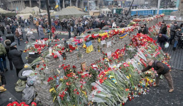 Flowers cover the barricades heading to Independence Square, Kiev, Ukraine