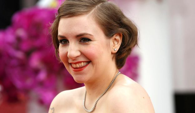 Lena Dunham poses on arrival at the 71st annual Golden Globe Awards in Beverly Hills.