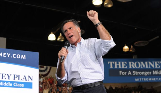 Supporters cheer US Republican presidential candidate Mitt Romney at a campaign rally in Las Vegas.