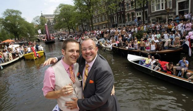 A couple getting married during Amsterdam's Pride Canal Parade.