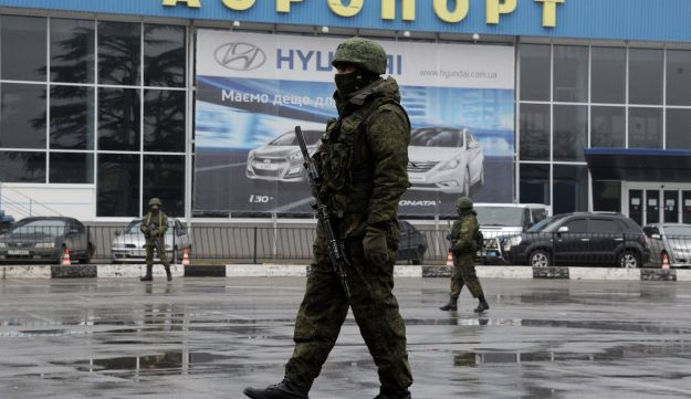 Armed Russian troops at a Ukrainian airport in Crimea, Friday February 28, 2014.