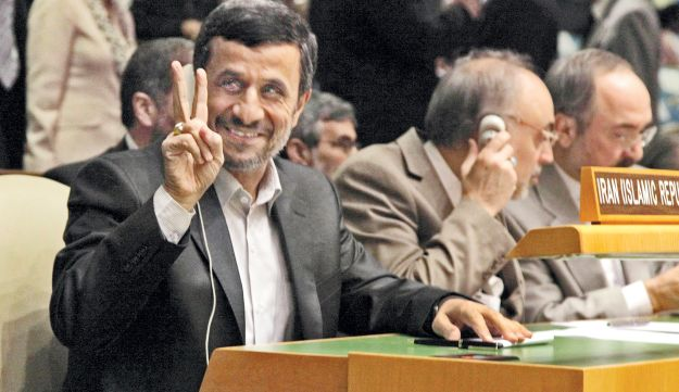 Iranian President Mahmoud Ahmadinejad flashing a victory sign during a UNGA session, Sept. 24, 2012.