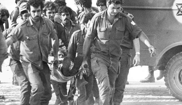 Soldiers evacuating an injured comrade during the Yom Kippur War in 1973.