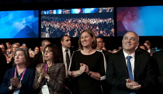Justice Minister and chief negotiator Tzipi Livni applauds.