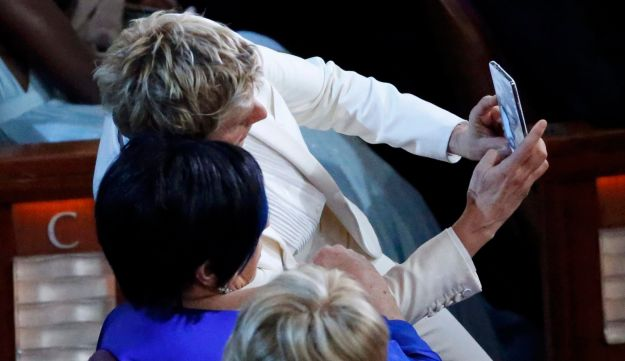 Ellen DeGeneres (top) takes a selfie with Liza Minnelli at the 86th Academy Awards in Hollywood.