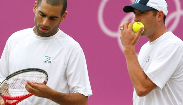 Ram and Erlich (R) confer at the London Olympics, August 1, 2012.