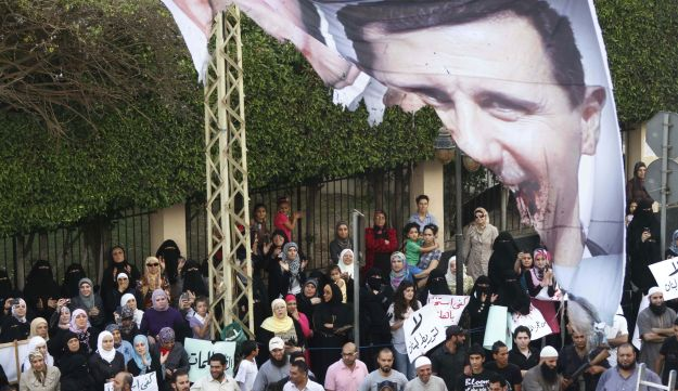 Protesters chant slogans against the Syrian regime and Russia's support of President Bashar Assad.