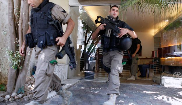Lebanese policemen at home of former Lebanese minister Michel Samaha - Reuters - August 9, 2012.