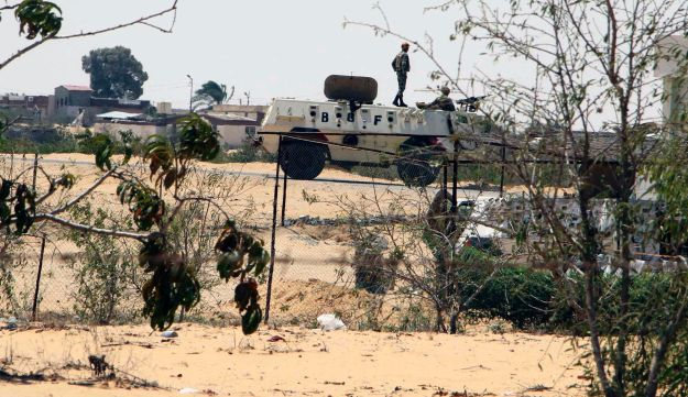 Egyptian border guards patrol near the border with Israel