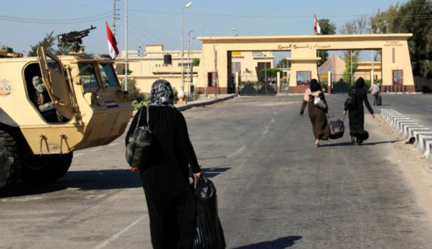 Palestinians walking toward the Egyptian border crossing with Gaza in Rafah, Egypt