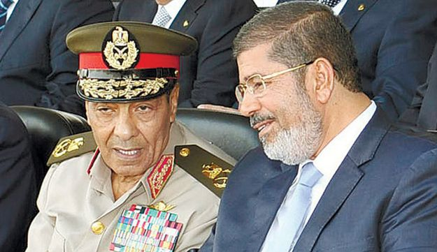 Hussein Tantawi, left, and Mohammed Morsi.