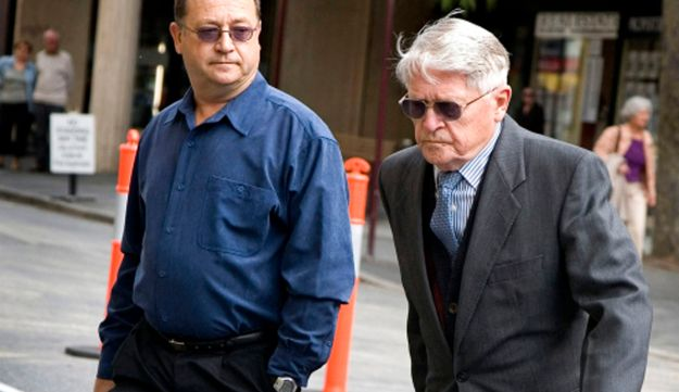 In this Sept. 22, 2006 file photo Charles Zentai, right, leaves the Perth Magistrates Court.