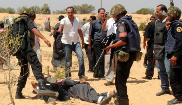 Egyptian security forces arrest suspected militants after a firefight at the al-Goura