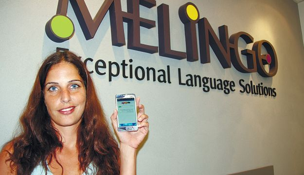 A Melingo staffer displaying the Morfix app on her phone at the company's TA headquarters Thursday.