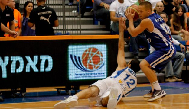 Israel team captain Yotam Halperin falls to the floor during a match against Estonia