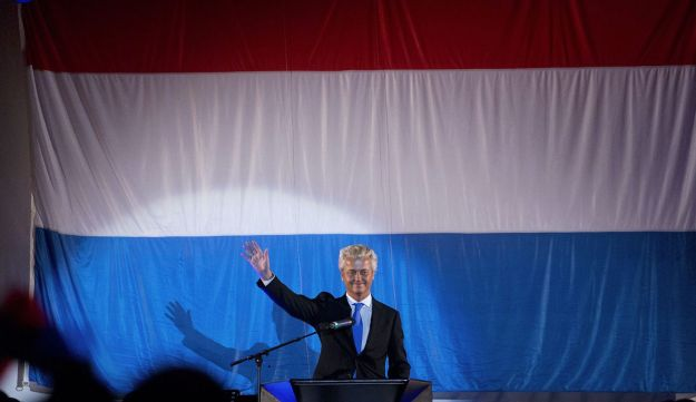 Populist Freedom Party leader Geert Wilders waves to his party members in Rotterdam August 24, 2012.