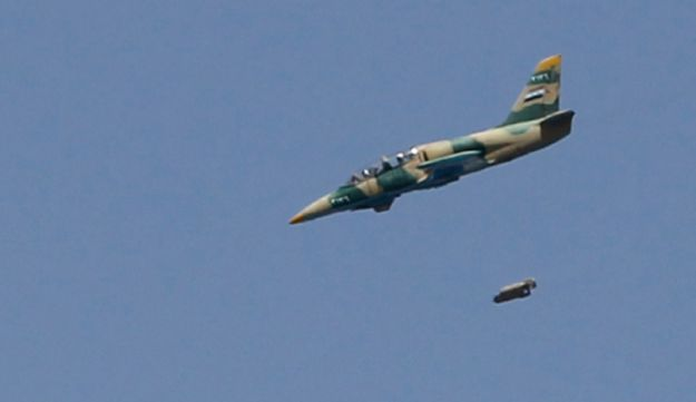 A Syrian Air Force fighter jet launches missiles - Reuters - September 1, 2012.