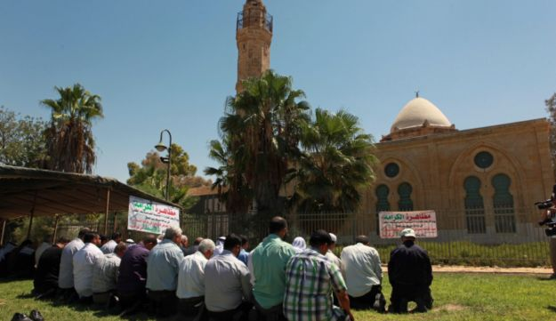 Arab Israeli activists protest an upcoming wine festival to be held in a mosque courtyard