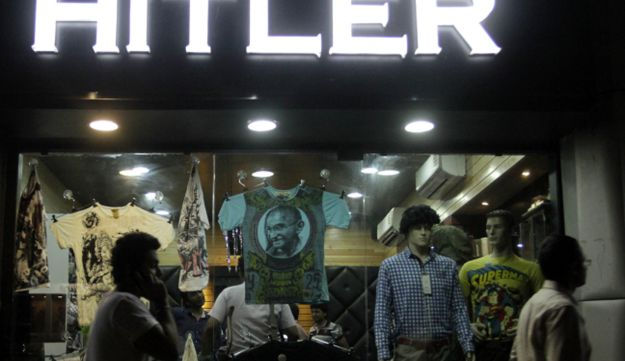 Indians walk past a shop named 'Hitler' in Ahmadabad, India, Aug. 29, 2012.