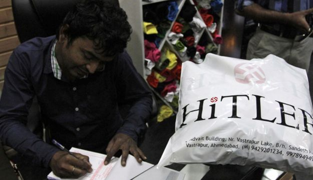 Rajesh Shah, one of the owners of a store named Hitler, prepares a bill for a customer in Ahmadabad,