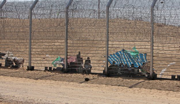 Eritrean citizens trapped between the fences on the Israeli-Egyptian border, September 5, 2012.