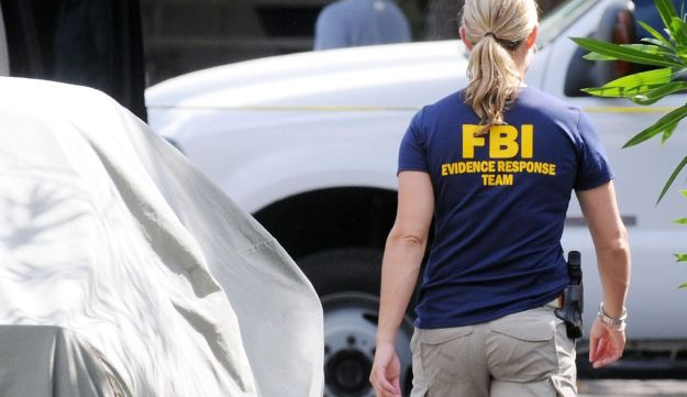 An FBI agent at the scene of the house where Ibragim Todashev was shot and killed.