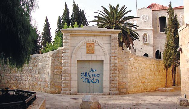 The graffiti outside the church in Jerusalem.