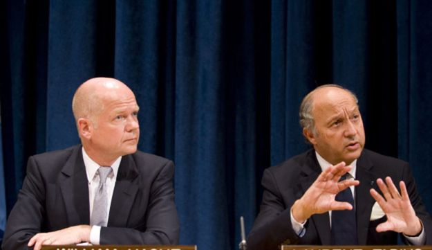 French Foreign Minister Laurent Fabius and British Foreign Secretary William Hague.