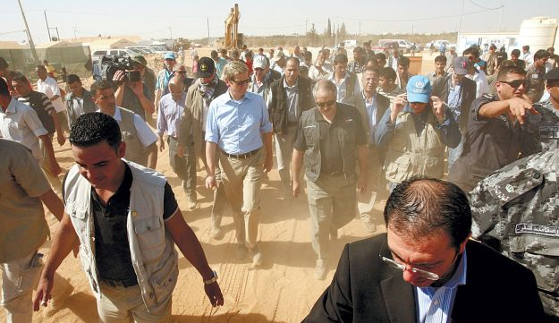 German Foreign Minister Guido Westerwelle, center, touring the Zaatari refugee camp.