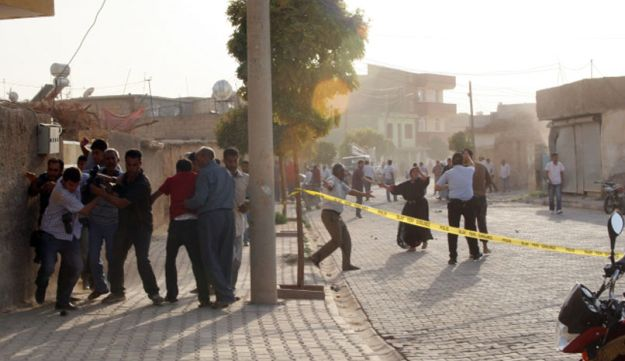 The explosion area after several Syrian shells crashed inside Akcakale town in Turkey - AFP.