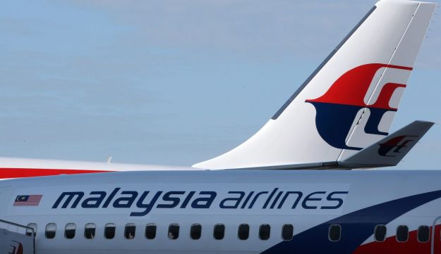 The Malaysian Airline System Bhd. logo is displayed on the company's aircraft
