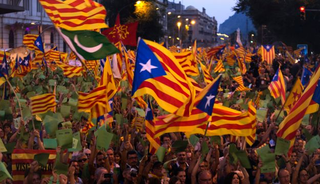 Demonstrators wave Catalan flags during a protest rally in Barcelona , Spain.