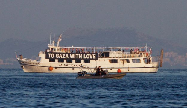 The activist run boat 'Audacity of Hope' is escorted by the Greek coast guard in 2011.