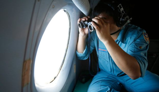 Vietnam Air Force crew searches for the missing Malaysia Airlines Flight 370.