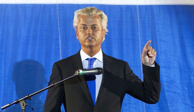 Wilders gestures to his party members at the start of a Freedom Party meeting in Rotterdam.