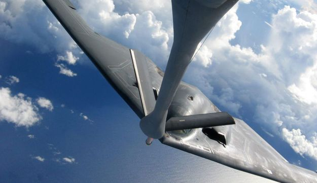 Air National Guard KC-135 tanker refuels a B-2 bomber.