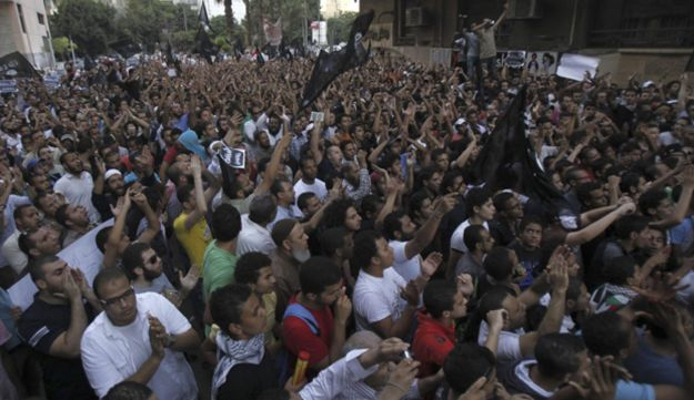People shout slogans in front of the U.S. embassy in Cairo