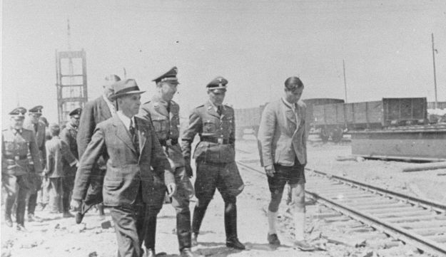 Hoess (second from right) touring Auschwitz with Heinrich Himmler.