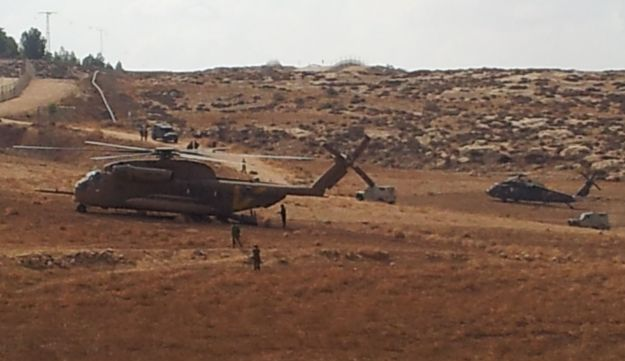 IDF troops attempting to locate and recover downed drone.