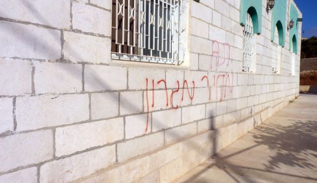 The graffiti on the wall of the mosque near Hebron